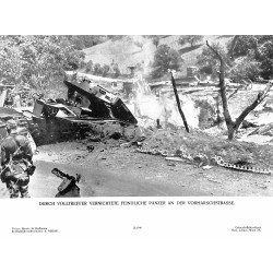 13829	 WWII press photo print	 Druch Volltreffer vernichtete feindliche Panzer an der Vormarschstrasse	 1940, Photo Hoffmann