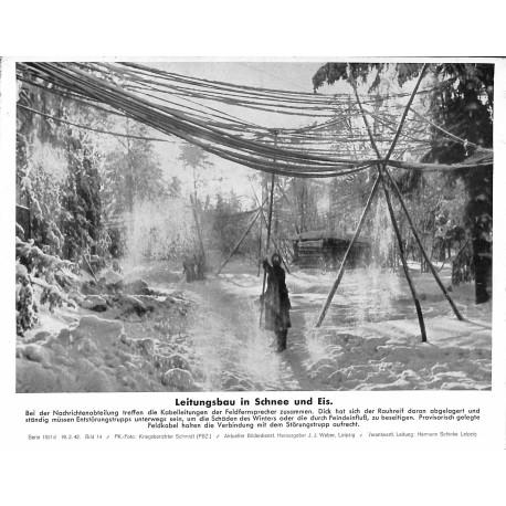 13831 WWII press photo print Leitungsbau in Schnee und Eis Russia, 1942, Serie 1501d
